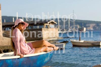 Tourist on the beach at Komiza, Vis island, Croatia