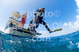Diver jumping from dive boat to dive at the British Virgin Islands, Caribbean
