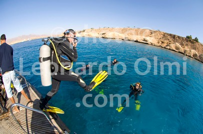 Egypt, Red Sea, Ras Umm Sid, divers jumping from liveabord dive deck
