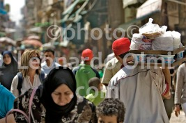 Egypt, Cairo, market of Khan el-Khalili, man with bag of arabic bread