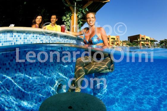 Egypt, Marsa Alam, Tulip Resort, swimming pool, tourist haveing drink at pool bar