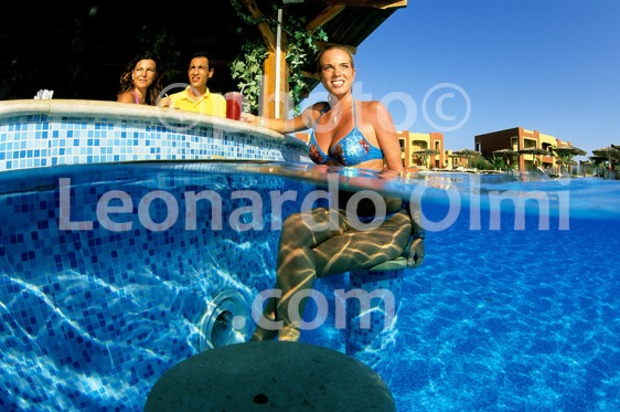 Egypt, Marsa Alam, Tulip Resort, swimming pool, tourist haveing drink at pool bar