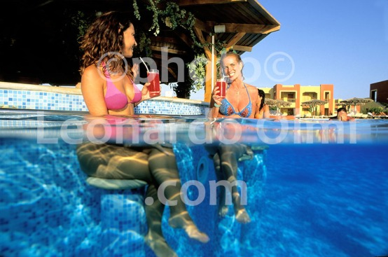 Egypt, Marsa Alam, Tulip Resort, swimming pool, tourists haveing drink at pool bar