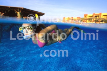 Egypt, Marsa Alam, Tulip Resort, tourist swimming inside pool