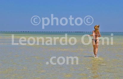 Egypt, Marsa Alam, tourist running on the beach