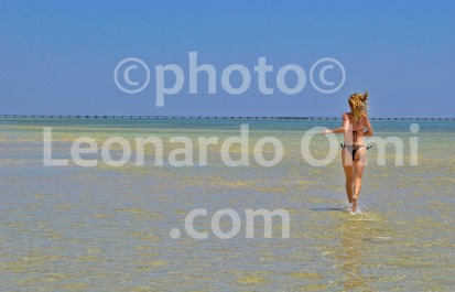Egypt, Marsa Alam, tourist running on the beach
