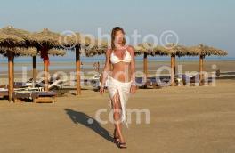 Egypt, Red Sea, Marsa Alam, Tulip Resort beach, girl walking DSC_5959 copy