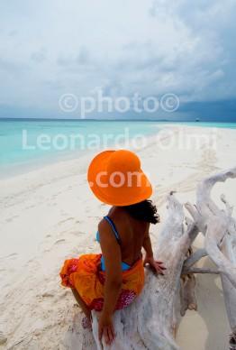 Tourist on white sand beach, desert island, Ari Atoll, Maldives