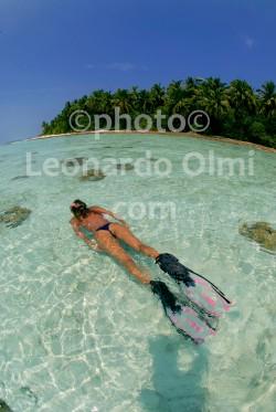 Maldives, girl snorkeling in front of a desert island DSC_3385 copy