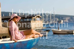 Croatia, Vis island, Komiža, beach, girl on boat DSC_0114 TIF copia copy